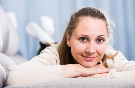 Young woman posing playfully in good humor in free time Stockfoto