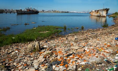 Old abandoned part of port area of Montevideo, garbage and landfill, La Plata gulf. Montevideo, Uruguay, South America