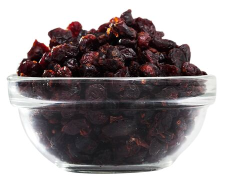 Glass bowl with sweet freeze-dried blueberries. Concept of healthy and diet food. Isolated over white background