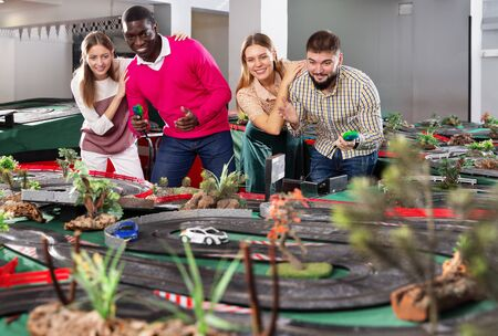 Girls with guys play together the modern slot car racing models