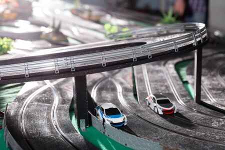 View of electric slot model cars on the toy race track ready to play in playroom