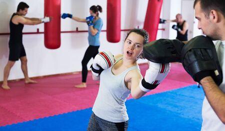 Portrait of sportswomen competing in colored boxing gloves Banco de Imagens