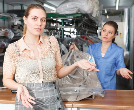 Female client expressing dissatisfaction with quality and prices of dry cleaning salon