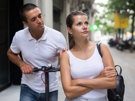 Young woman offended on her boyfriend during promenade in city Reklamní fotografie