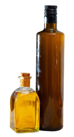 Organic vegetable oil in bottles on wooden background. Isolated over white background