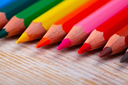 Closeup of colored lead pencils for drawing on wooden surface Stock fotó