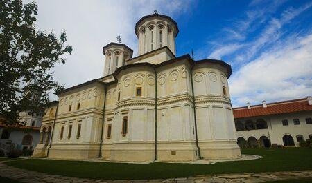 Monastery Horezu is architectural landmark outdoors. Stock Photo