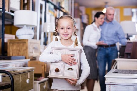 smiling young girl with curbstone in furniture store.