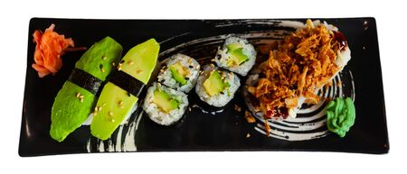 Set of different sushi - maki, california and nigiri. Japanese cuisine. Isolated over white background