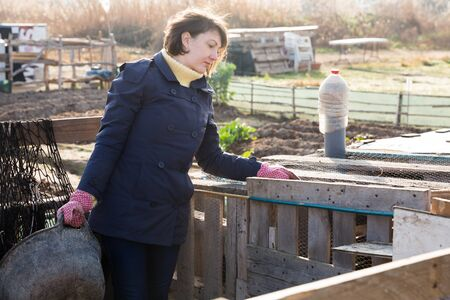 Farmer girl in the backyard of a village house