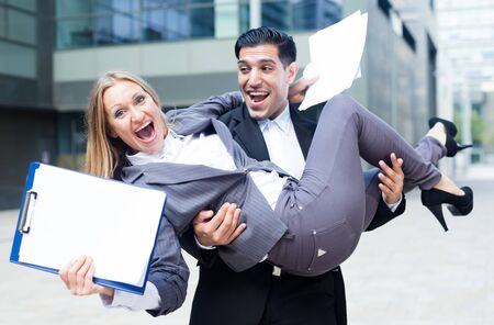 Businesswoman is on hands of her partner because they are signed successful contract outdoors near office.