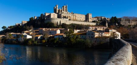 View of Cathedral of Saint Nazaire across Orb river, Beziers, France