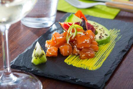 Delicious fresh tuna tartar with avocado dressed with spicy mango sauce