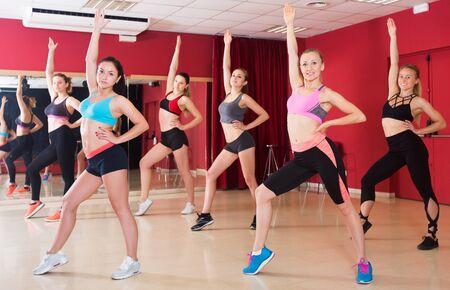 Young slim athletic women dancing strip plastic in studio