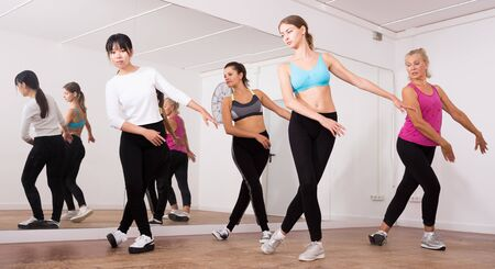 Ordinary active females exercising dance moves