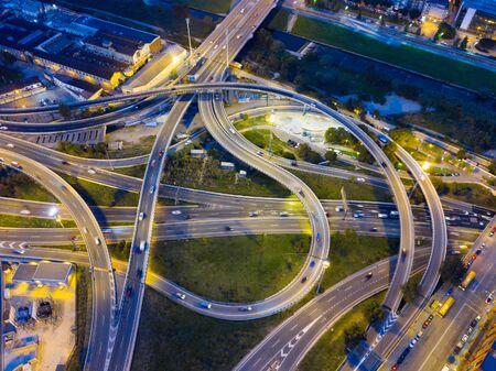 Aerial view of lighted highway road junctions at night 版權商用圖片