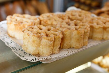 Closeup of tray with delicious sweet pastry presented on bakery showcase