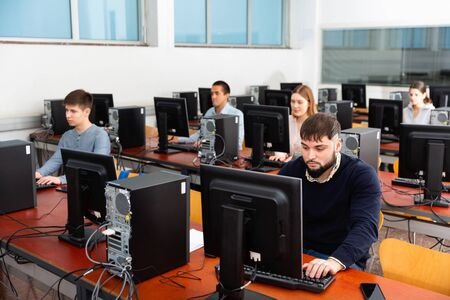 Computer lessons for positive serious adults in classroom