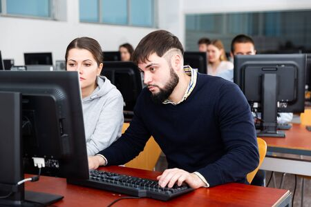 University students are engaged in computer class