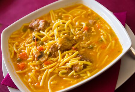 Bowl of traditional catalonian meal Fideos a la cazuela con costilla Stock Photo