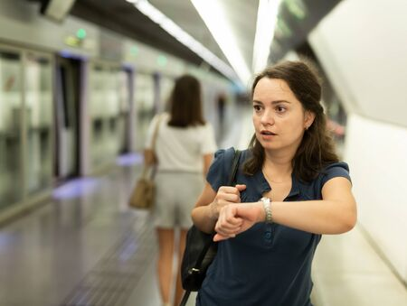 Hurrying woman is late for subway train