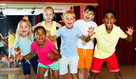Happy emotional cheerful positive  children posing at modern dance class