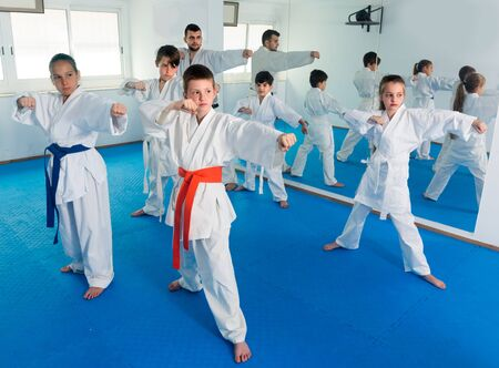 Trainer is training young teenagers in karate class.  写真素材