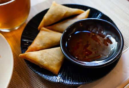 Potato curry samosas served with sause at plate, nobody 写真素材