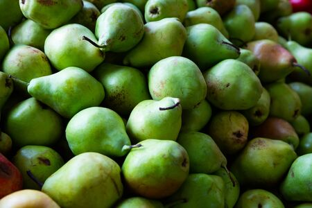Fresh ripe pears in box ready for sale
