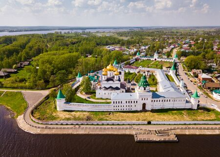 Scenic spring landscape of Kostroma city overlooking Holy Trinity Ipatiev Monastery on riverbank, Russia