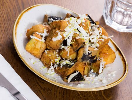 Plate with prepared food eggplants with honey and cheese