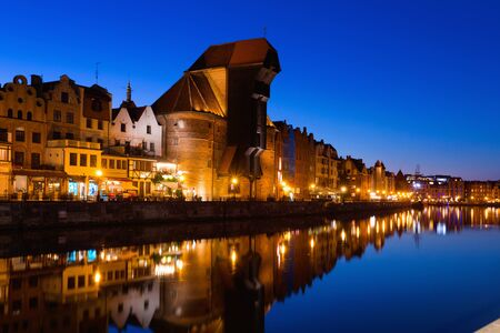 Picturesque Motlawa river embankment in old Polish town of Gdansk in twilight Imagens