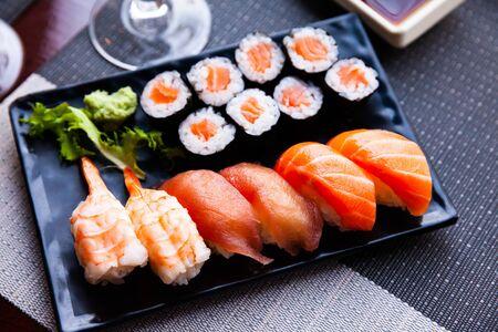 Combined sushi - maki salmon, nigiri variado closeup. Japanese cuisine