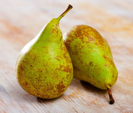 Ripe green pears on wooden background. Healthy vitamin product