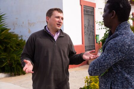 Friendly neighbors discuss on the farm in village
