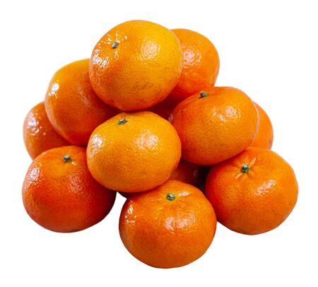 Pile of whole ripe organic clementines. Isolated over white background Stock Photo