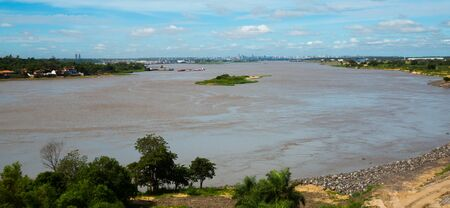 The wide Paraguay River with brown water in capital city Asuncion