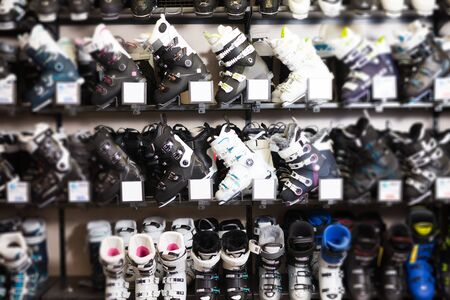 new ski boots for sale in modern store of sports equipment