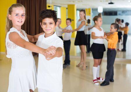 smiling  english children  dancing pair dance in class