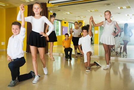Children  dancing pair dance in class Фото со стока