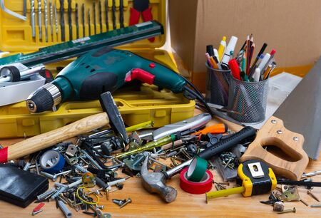Table littered with various construction tools