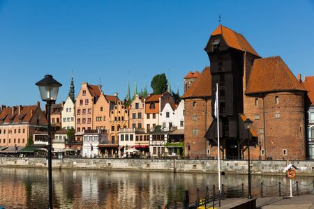 Motlawa river embankment in historical part of Gdansk at sunny day, Poland
