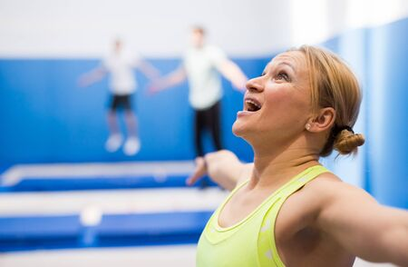 Close up portrait of athletic woman training in indoor trampolines center