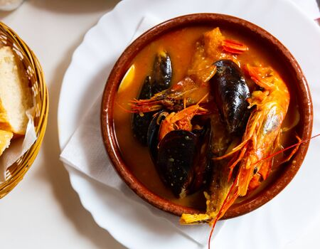 Delicious seafood soup with shrimps and mussels – dish of Mediterranean cuisine