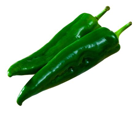 Whole fresh green chili peppers. Vitamin cooking ingredients. Isolated over white background Banco de Imagens