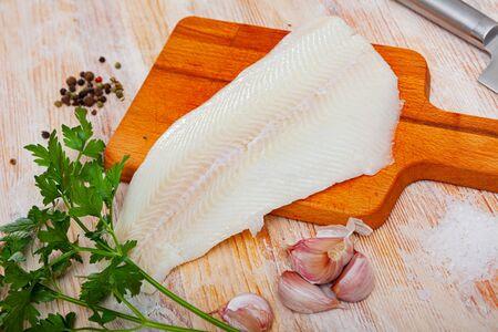 Fresh raw fillet of halibut fish on wooden background Reklamní fotografie