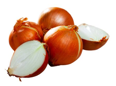 Whole bulbs and halves of raw organic onion. Isolated over white background