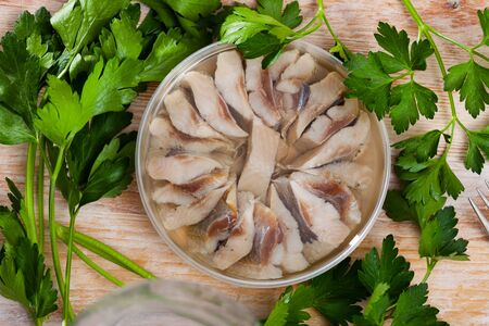 Preserved sardines marinated in oil in plastic container Stok Fotoğraf