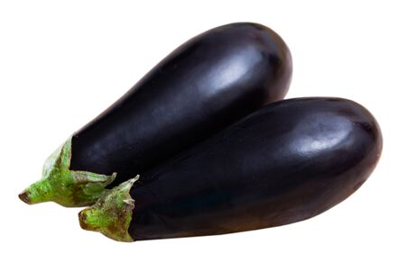 Closeup of fresh eggplants. Healthy vegetarian ingredient. Isolated over white background