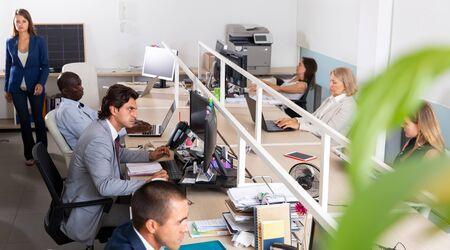 Working process in open space modern office Banco de Imagens